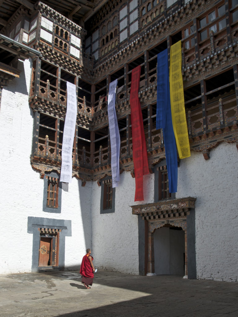 Freshly printed prayer flags drying in the courtyard of Trongsa Dzong